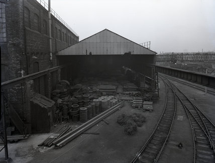 Works photographic negative of exterior view of the plate shed, 1959.