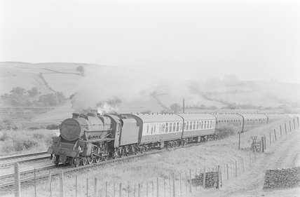 A steam locomotive pulling a passenger train,A1969.70/Box 5/Neg 1241/33