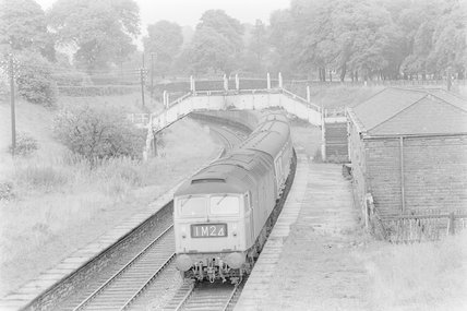 A diesel locomotive pulling a passenger train,A1969.70/Box 5/Neg 1241/35