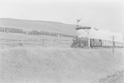 A steam locomotive pulling a passenger train,A1969.70/Box 5/Neg 1243/26