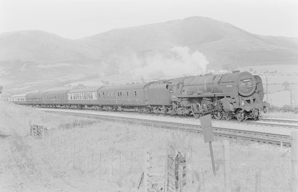 A steam locomotive pulling a passenger train,A1969.70/Box 5/Neg 1247/32