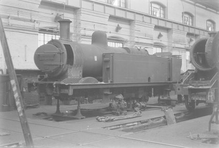Photographic negative taken by John Clarke of two steam locomotives under repair in a workshop,A1969.70/Box 5/Neg 1251/34