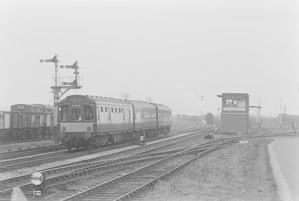 A diesel locomotive pulling a passenger train,A1969.70/Box 5/Neg 1252/5
