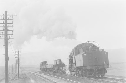 A steam locomotive shunting goods wagons,A1969.70/Box 5/Neg 1257/13