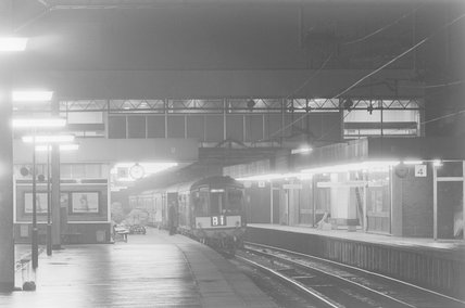 A diesel locomotive with passenger train B1 in a station at night,A1969.70/Box 5/Neg 1260/31