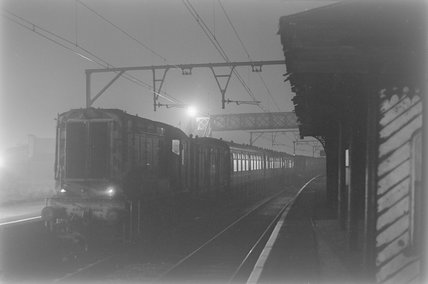 A diesel electric shunter with passenger carriages, photograph taken at night,A1969.70/Box 5/Neg 1264/17