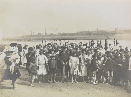 Children at play on the banks of the River Mersey, 1918.