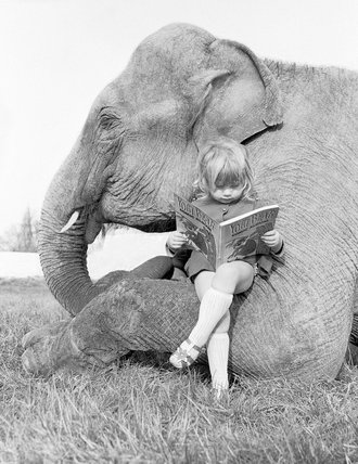 Girl and elephant relax