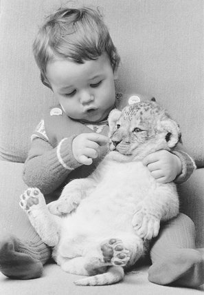 Boy and lion cub