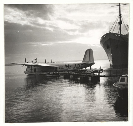 Flying boat moored at a jetty, c 1935.