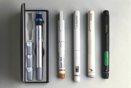 Group of insulin delivery devices, 1985-1993.