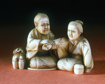 Netsuke of doctor and patient, Japanese, late 19th century.