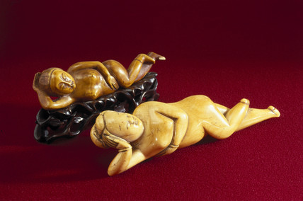 Netsuke showing reclining female figures.