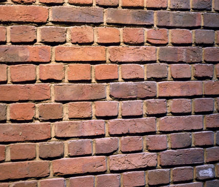 A brick wall, late 20th century.