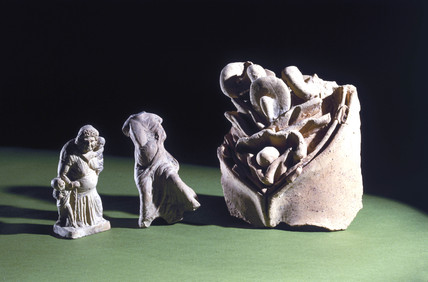 Roman votive viscera and two pregnant figures.