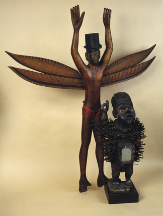 A Nicobar Island figure and an African fetish figure.
