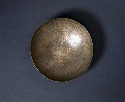 Small bras divination bowl, 19th century.