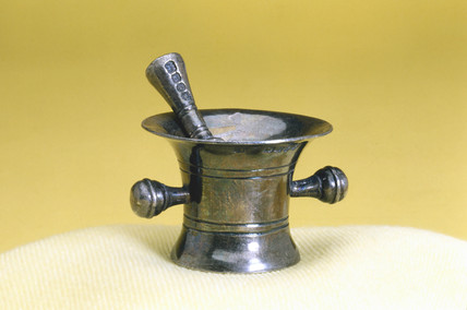 Miniature mortar and pestle, silver, c 1901.