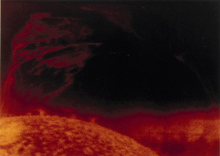 Solar flare seen in helium 3 light, photographed from Skylab, 1973.