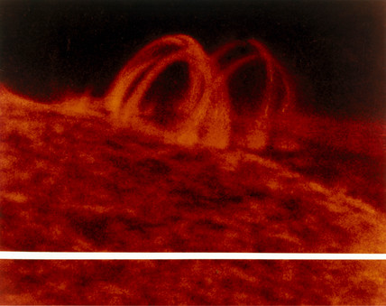 Post-flare loop above the Sun's surface, ultraviolet photograph from Skylab, 1973.