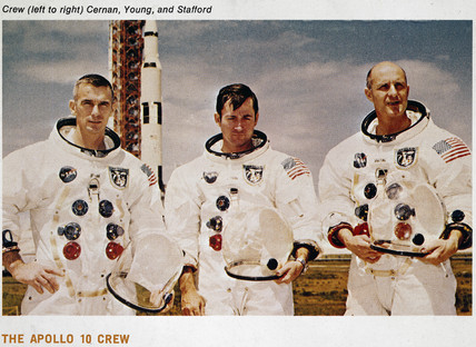 Apollo 10 crew and Saturn V rocket, 1969.