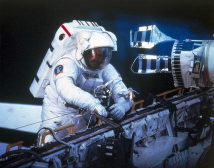 Shuttle astronaut with a home made tool on Space Shuttle mision 51-D, 1985.