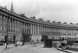 A bomb crater in the lawn outside 21 Royal Crescent, Bath, April 1942