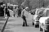 A protester campaigning for Rail not Roads 4 April 1994