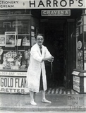 Mr Arthur Harrop mops up his shop in Weston Village, Oct 1968