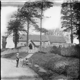 Cyclist and tricycle outside Church of St Christopher at Ditteridge c.1890s