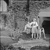 Children with tiger skin and dog, probably at South Wraxall Manor, c.1890s