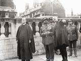 Haile Selassie looking up at Bath Abbey's tower, 18 Oct 1954