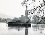 The flooded cricket ground, looking towards St Johns catholic church, 1960