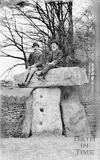 Three Shire Stones with two men sat on top c.1905
