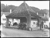 Two gentlemen posing under the market cross, Castle Combe c.1900