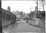 View down the street towards Nunney Castle, c.1920s