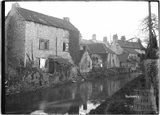 Houses in Nunney, viewed across the stream, c.1920s