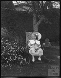 A delightful portrait of a young girl in the garden c.1900