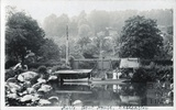 View across the river at Batheaston to a group of people. Kyrle boathouse c.1910