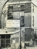 Advertisement for Gaes Cars, carriage hire on a building in James Street West, Bath c.1950s