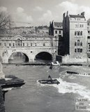 A flood, partially submerging a crane, during the construction of the new weir at Pulteney Bridge, pre 1973