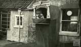 Punch and Judy in the garden of the Larkhall Inn, 1950s