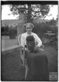 Lady with dog, Monkton House, Warminster Road, Limpley Stoke c.1910s