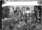 Mr and Mrs Unwin and family in their garden c.1910
