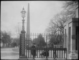 Family behind gates at entrance to Royal Victoria Park, c.1905