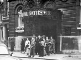A group of people outside the New Royal Baths, c.1940s