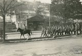 Troops marching along the London Road past Kensington Gardens, c.1916