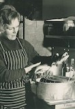 An early portrait of popular food writer and television presenter Mary Berry cooking fish, 1 Feb 1971