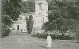 The photographer's wife Violet in front of St Peters church, Stourhead, c.1930s