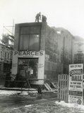 The demolition of Pearce's Hardware Store, 38 Monmouth Street, Bath, 1962